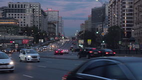 Cityscape at dusk with the cars traffic on a large city street Stock Footage