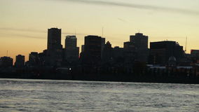 Cityscape at dusk with cruise ship stock video footage