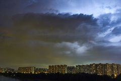 Cityscape at dusk with thunderstorm over apartments buildings Royalty Free Stock Image