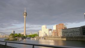 Cityscape of Dusseldorf. Over the Rhine river in a sunny summer day stock video footage