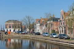 Cityscape Dutch village Makkum with historic houses along a canal royalty free stock photos