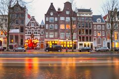 Cityscape - evening view of the houses with festive decorations and the city channel with boats, city of Amsterdam. The Netherlands Stock Photos