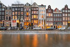Cityscape - evening view of the houses with festive decorations and the city channel with boats, city of Amsterdam. The Netherlands Stock Images