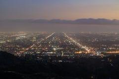 Cityscape för Hollywood områdessolnedgång från Griffith Park Arkivfoto