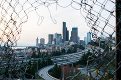 Cityscape through fence framing royalty free stock image
