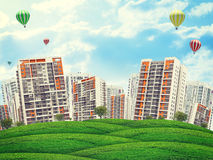 Cityscape on field, under blue sky with ballooons. Cityscape on field under blue sky with trees and balloons Stock Image