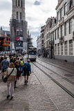 Cityscape of Ghent. Ghent, Belgium - July 31, 2016: Cityscape of Ghent with tram and a crowd of tourists Royalty Free Stock Photo
