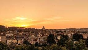 Cityscape at gold sunset on Rome. Saint Peter Dome silhouette on horizon. Timelapse landscape stock video