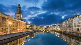 Cityscape of Gothenburg from Big Harbor Canal. Cityscape with Big Harbor Canal and Christinae Church at dusk in Gothenburg, Sweden static image with animated sky stock footage