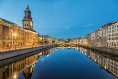 Cityscape of Gothenburg from Big Harbor Canal. Cityscape with Big Harbor Canal and German Church Christinae Church at dusk in Gothenburg, Sweden royalty free stock photo