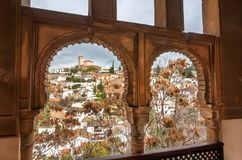 Cityscape of Granada from window of historical house in traditional architecture style of Andalusia region, Spain. Cityscape of Granada from window of the royalty free stock photos