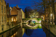 Cityscape with a Green canal in Bruges at night Royalty Free Stock Photo