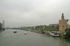 The cityscape with Guadalquivir river in Seville,. Spain royalty free stock photos