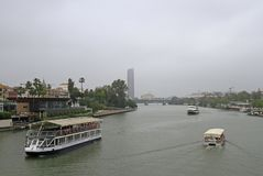 The cityscape with Guadalquivir river in Seville,. Spain royalty free stock photography