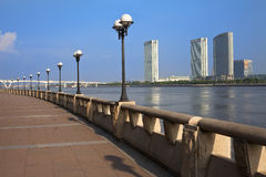 Cityscape of Guangzhou City. Cityscape of sidewalk,banisters,streets lamp and commercial buildings on the both sides of the Pearl River in Guangzhou City,China Stock Images