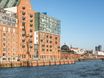 Cityscape of Hamburg, Germany, with historic warehouses, fish auction hall and river Elbe Royalty Free Stock Photography