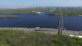 Cityscape highway and traffic on the bridge over the Dnieper River Kiev stock footage