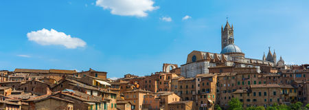 Cityscape of the historic town of Siena, Italy Stock Photos