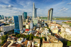 Cityscape of Ho Chi Minh city at beautiful sunset, viewed over Saigon river. Royalty Free Stock Photography