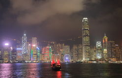 Cityscape Hong Kong för Victoria hamnnatt Arkivbild