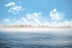 Cityscape on horizon over ocean Stock Photos