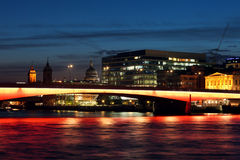 Cityscape with illuminated London Bridge at night. The London Bridge across Thames river at night Royalty Free Stock Photo