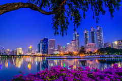 Cityscape image of Benchakitti Park at twilight time in Bangkok, Royalty Free Stock Photos