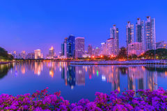 Cityscape image of Benchakitti Park at twilight time in Bangkok, Stock Images
