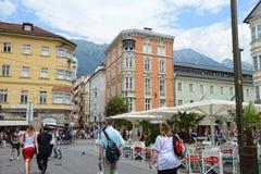 Cityscape of Innsbruck on Inn river Tirol Austria. Innsbruck, Tirol/ AUSTRIA July 18 2013: Cityscape of Innsbruck on Inn river Tirol Austria. people walking royalty free stock images