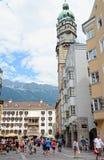 Cityscape of Innsbruck on Inn river Tirol Austria. Innsbruck, Tirol/ AUSTRIA July 18 2013: Cityscape of Innsbruck on Inn river Tirol Austria. People walking stock photos