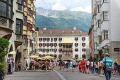 Cityscape of Innsbruck on Inn river Tirol Austria. Innsbruck, Tirol/ AUSTRIA July 18 2013: Cityscape of Innsbruck on Inn river Tirol Austria. People walking stock photography
