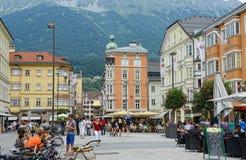 Cityscape of Innsbruck on Inn river Tirol Austria. Innsbruck, Tirol/ AUSTRIA July 18 2013: Cityscape of Innsbruck on Inn river Tirol Austria. people walking royalty free stock photo