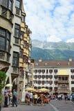 Cityscape of Innsbruck on Inn river Tirol Austria. Innsbruck, Tirol/ AUSTRIA July 18 2013: Cityscape of Innsbruck on Inn river Tirol Austria. People walking royalty free stock image