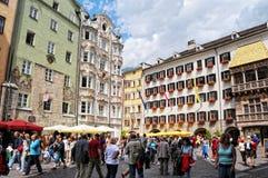 Cityscape of Innsbruck on Inn river Tirol Austria. Innsbruck, Tirol/ AUSTRIA July 9 2009:Cityscape of Innsbruck on Inn river Tirol Austria. People walking along stock photo