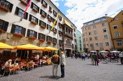Cityscape of Innsbruck on Inn river Tirol Austria. Innsbruck, Tirol/ AUSTRIA July 9 2009:Cityscape of Innsbruck on Inn river Tirol Austria. People walking along royalty free stock image