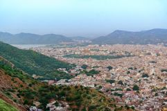 Cityscape of Jaipur city with the bordering aravali hills. And the city of Amber at the base. The cloudy sky and mountains in the background add to the beauty Stock Photography