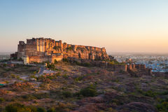 Cityscape at Jodhpur at dusk. The majestic fort perched on top dominating the blue town. Scenic travel destination and famous tour Royalty Free Stock Photography