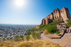 Cityscape at Jodhpur at dusk. The majestic fort perched on top dominating the blue town. Scenic travel destination and famous tour Stock Images