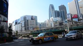 Cityscape and JR yamanote line of train tokyo metro with traffic road at Shinjuku city stock footage