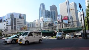 Cityscape and JR yamanote line of train tokyo metro with traffic road at Shinjuku city stock video footage