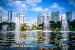 Cityscape of Kuala lumpur city skyline with fountain on blue sky Stock Image