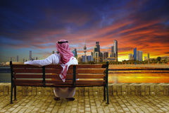 Cityscape of kuwait. A sitting on bench and looking at the cityscape of kuwait royalty free stock image