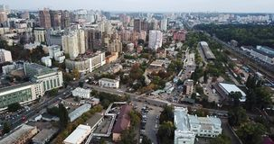 Cityscape of Kyiv in Ukraine. Green cityscape of Kyiv, Ukraine. There are buildings, roadways, railway tracks and many trees. Aerial video recording stock video footage