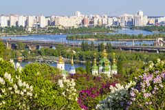 Cityscape of Kyiv with lilac blossom in spring