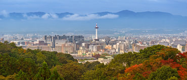 Cityscape of Kyoto, Japan. Cityscape of Kyoto with tower and autumn trees in Japan Stock Images