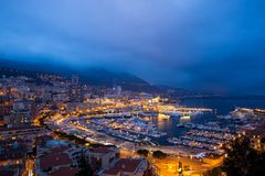 Cityscape of La Condamine at night, Monaco. Principality of Mona Stock Photo