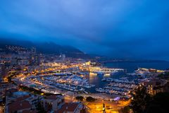 Cityscape of La Condamine at night, Monaco. Principality of Mona Stock Image