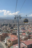 Cityscape of La Paz, Bolivia with Illimani Mountain rising in th Royalty Free Stock Photos