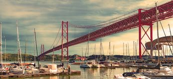 Bridge of April 25 in Lisbon. Cityscape of Lisbon and seaport. Entertainment and leisure in Portugal.Boats, sailboats and yachts in the port stock photo