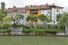 Cityscape in Ljubljana, Slovenia. Cityscape with people walking along the river bank Ljubljana is the capital and largest city of independent Slovenia since Royalty Free Stock Photo